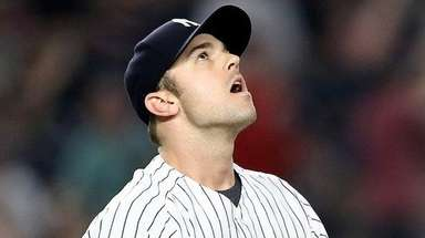 Yankees reliever David Robertson reacts after he gave
