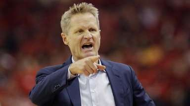 Warriors head coach Steve Kerr signals during the