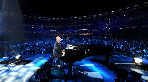 Billy Joel on stage at Shea Stadium on