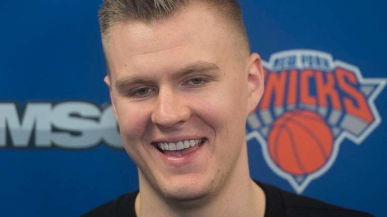 The Knicks' Kristaps Porzingis speaks with the media