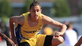 Travis Colon of Comsewogue wins the 110-meter high