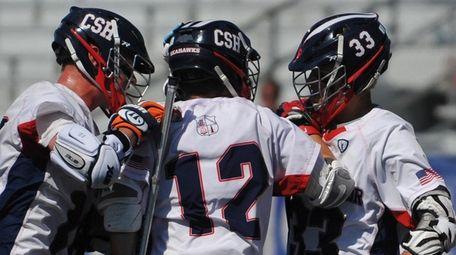 Brady Strough, center, gets congratulated by teammates Teddy