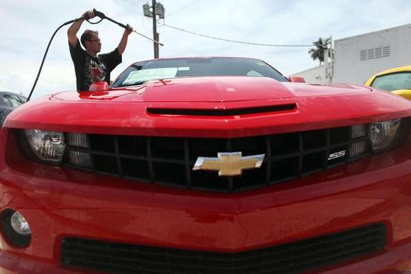 Nelson Ortiz washes new Chevrolets on the sales