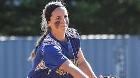 East Meadow's Jenna Laird tosses to second during