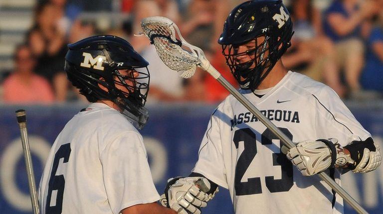 Matt Weigand #23, left, and goalie Mike Venezia
