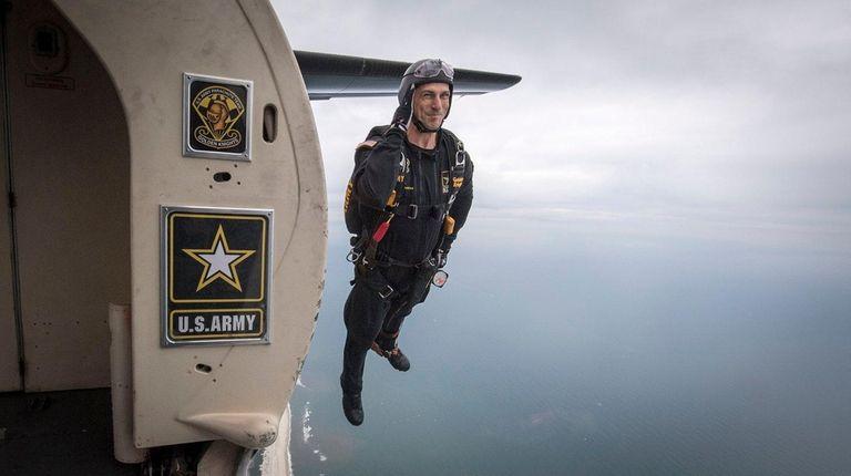 A Golden Knights parachuter jumps from a plane