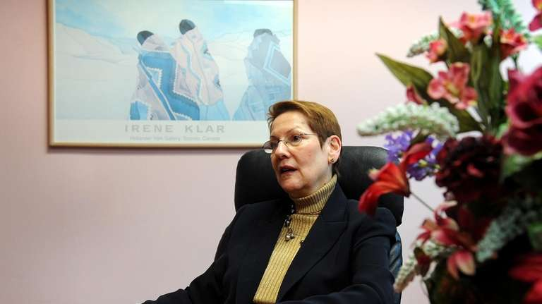 Ellen Cooperperson, president of Corporate Performance Consutants, poses