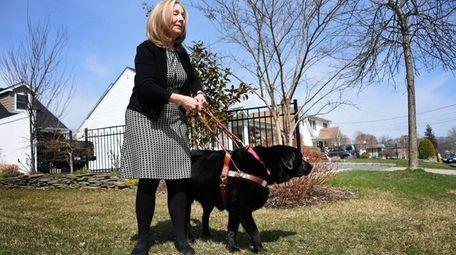 Dwyer-Blair walks with her guide dog Keegan