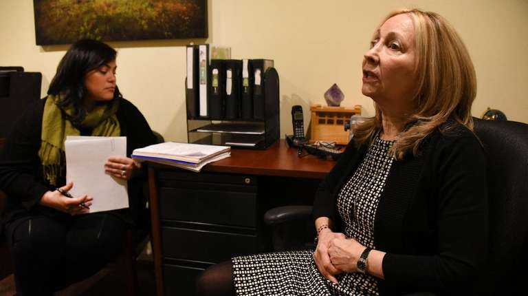 Kathleen Dwyer-Blair, right, meets with an employee in