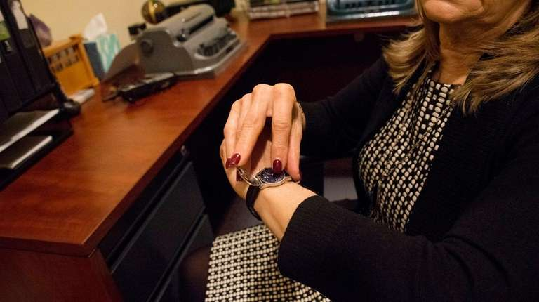 Dwyer-Blair checks the time on her Braille watch