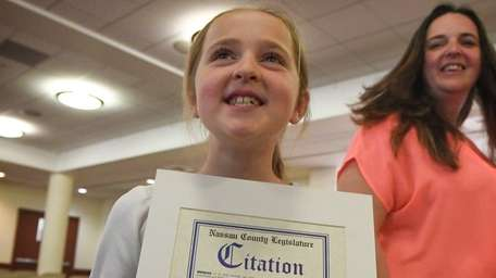 Emma received a citation for her charitable work