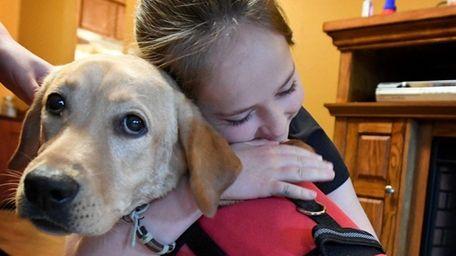 Emma Brussell hugs Rufus, her diabetic alert