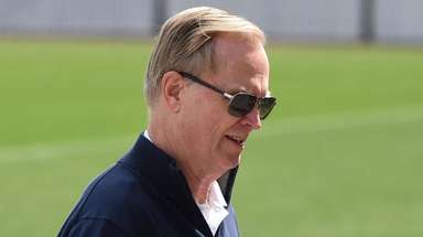 Giants president and CEO John Mara looks on