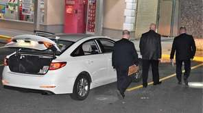 Police investigate a shooting involving two occupants of