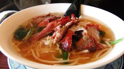 Roast pork chow fun noodle soup at Dragon
