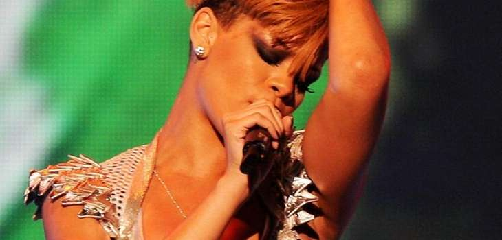 Singer Rihanna performs onstage in concert presented by