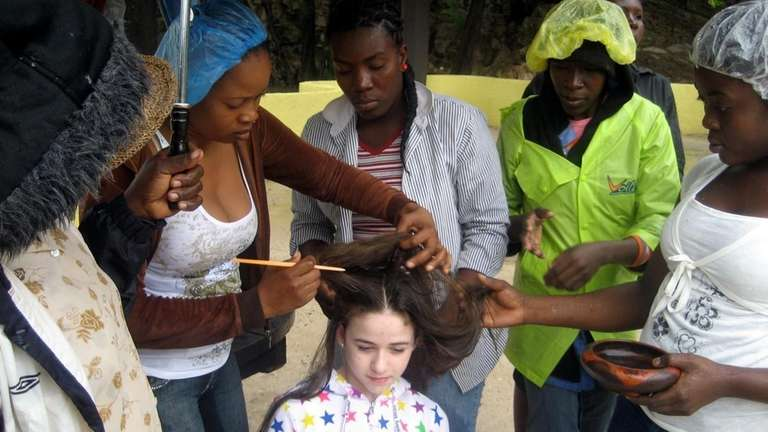 Kidsday reporter Laura Fallick gets her hair braided