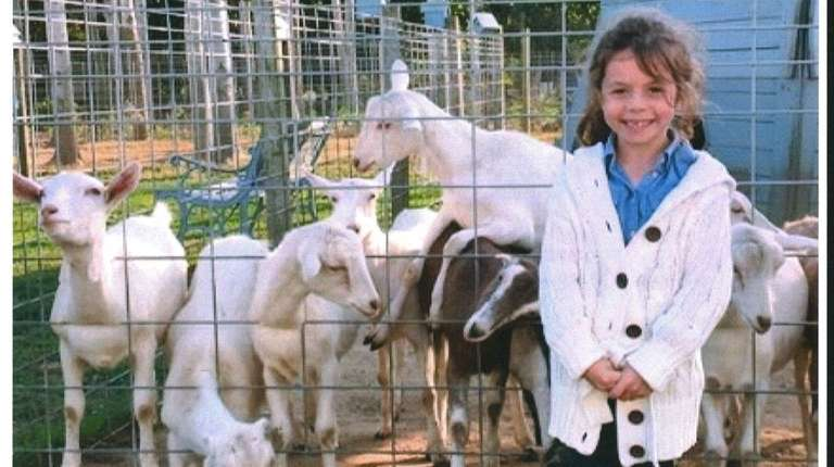 Kidsday reporter McKenna Clark visits the goats at