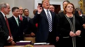 President Donald Trump answers questions Thursday at the