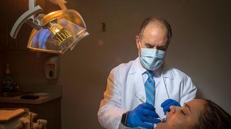 Dr. Scott Asnis, the CEO of Dental365, at