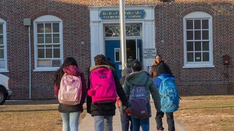 Students arrive at Barack Obama Elementary School on