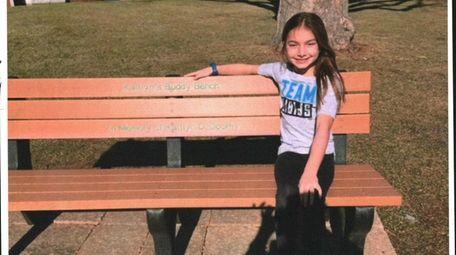Kidsday reporter Kaitlyn Garrett sits on Cutchogue East