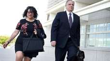 Linda and Edward Mangano walk up the steps
