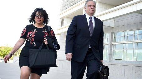 Linda and Edward Mangano walk up the steps