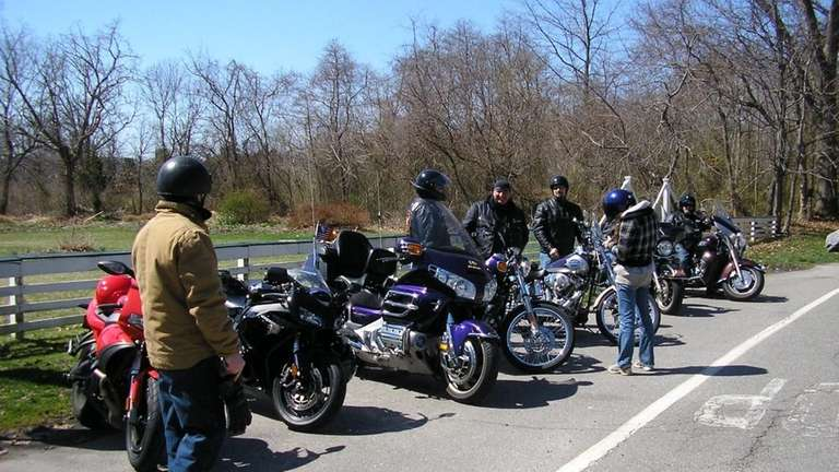 Members of the Nassau Wings Motorcycle Club take