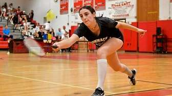Commack's Emily Haber reaches to make a return