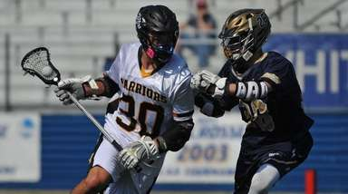 Wantagh's Ethan Insinga, left, gets pressured by Bethpage's