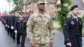 Staff Sgt. John Clement, left, marches in the