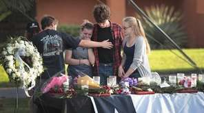 Students mourn at a community dinner on May