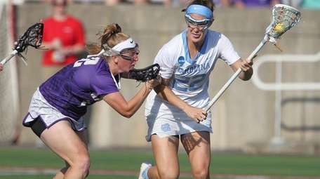 James Madison's Rebecca Tooker defends North Carolina's Maggie