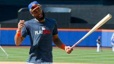 Mets shortstop Amed Rosario has a laugh during
