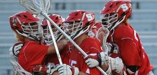 Syosset teammates celebrate after their 9-4 win over