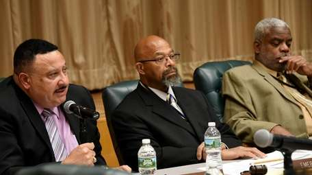 Uniondale Superintendent William Lloyd, left, school board President