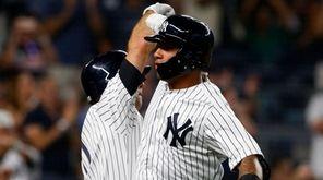 Yankees second baseman Gleyber Torres celebrates his seventh-inning