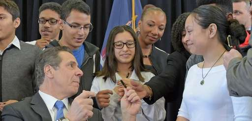 Gov. Andrew Cuomo hands out pens to Brentwood