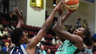 Liberty center Tina Charles shoots defended by Lynx