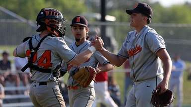 Babylon's Gino Vano is congratulated by catcher Eric