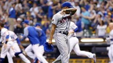 Mets pitcher AJ Ramos walks off the field