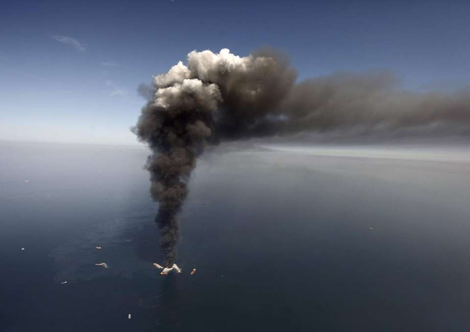 A deepwater oil platform burns after a massive