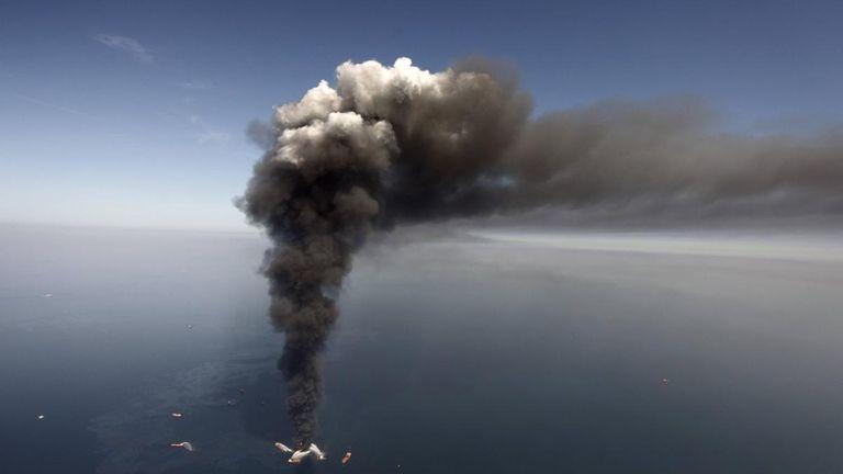 A deepwater oil platform burns after a massive