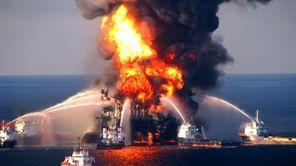 Fire boat crews battle a raging fire on