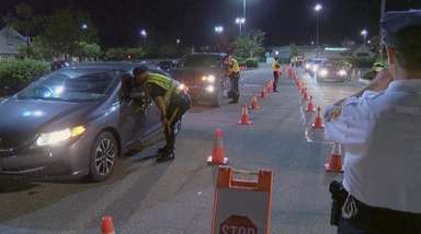 Police at a sobriety checkpoint Friday night in