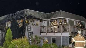 Firefighters respond to a condo complex fire on