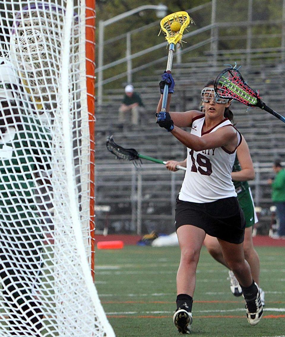 Garden City's Shannon Mangini scores in her team's
