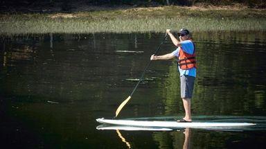 A paddler meets the stillness of Stony Brook
