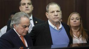 Harvey Weinstein with his attorney Benjamin Brafman, left,